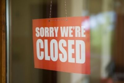 sign on door saying closed