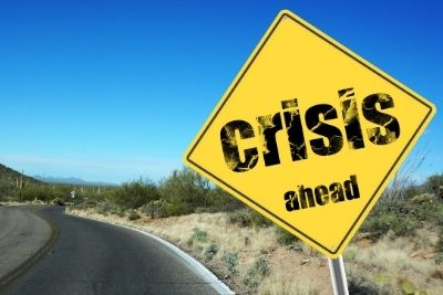 Sign on road saying 'crisis ahead'