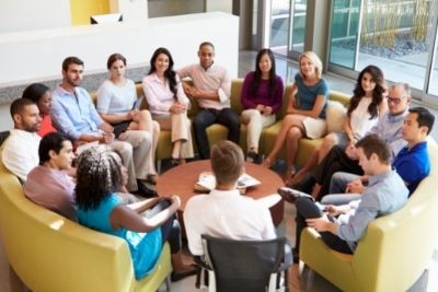 Group of colleagues sat in a circle