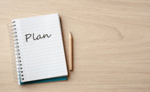 Notebook with Plan written on it